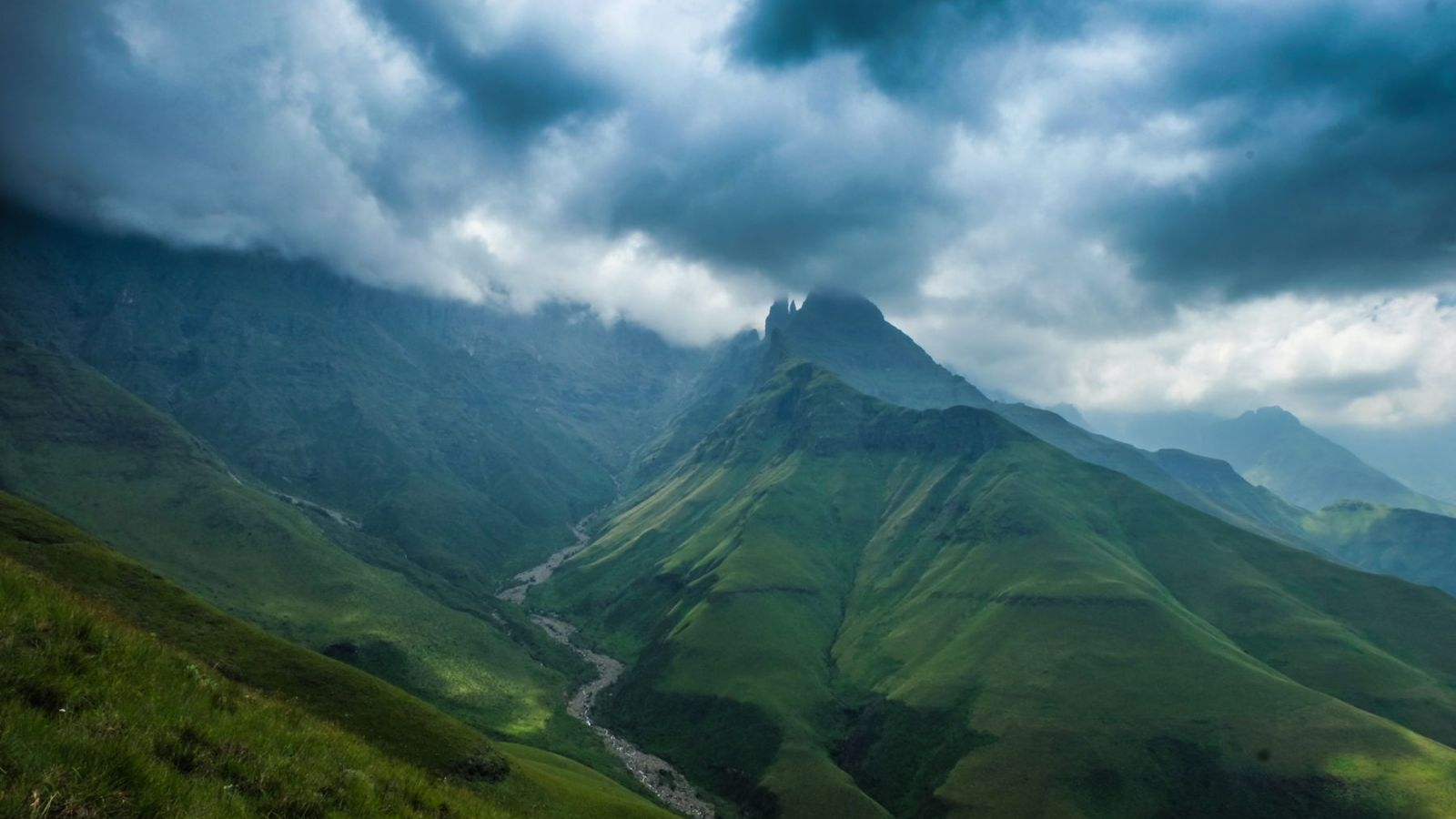 photo of a peak in the drakensberg mountains partially covered in clouds