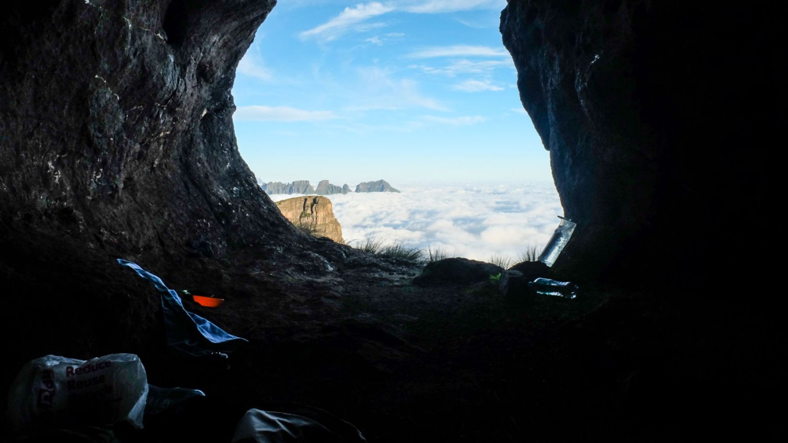 view from the cave in the drakensberg mountains showing clouds in the valley