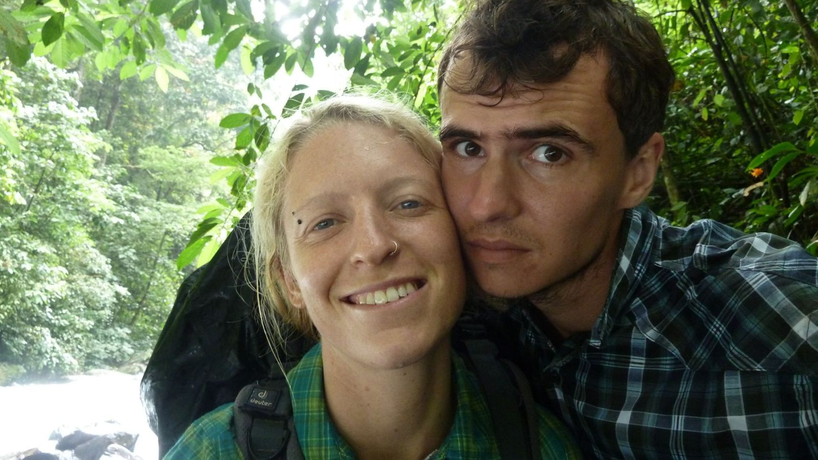 photo of two hikers in gunung leuser national park.