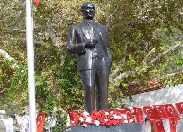 Statue of Atatürk on main square of Kaş is adorned with flowers in honor of his birthday