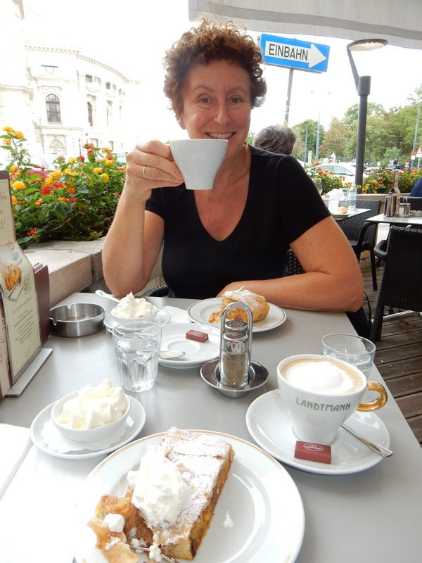 Laura envoys coffe with Apfelstrudel mit shlag (heavy cream) at Cafe Landtmann, Vienna
