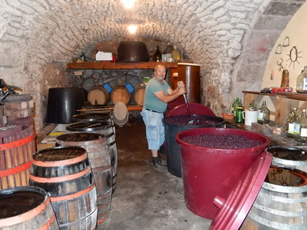 We peered into a door in an alley in BOsa and found this guy stirring the wine vats