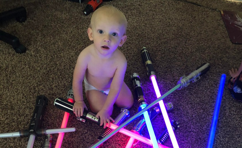 baby with lightsabers