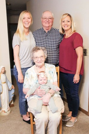 Eileen Duryea of Seneca is honored for a gathering to meet her great-great-granddaughter. Pictured are FRONT Eileen Duryea holding her great-great-granddaughter Willa Jay Emert of Seattle, Washington; BACK ROW (L-R) great-granddaughter Jordyn Emert of Seattle, son Ron Duryea and granddaughter Liese Haverkamp, both of Topeka.