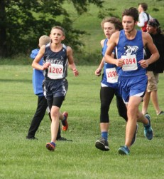 Sophomore Braden Menold keeps the pace with this pack of runners during the boys' cross country race on Thursday, October 4, at the Sabetha Golf and Country Club.