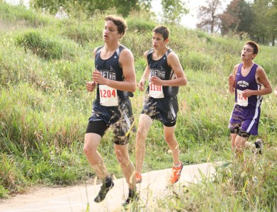 Micah Romines and Darrin Funk stay together on the course during the boys' cross country race on Thursday, October 4, at the Sabetha Golf and Country Club.