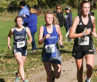 Junior Madisen Cochran paces herself as she closes in on this St. Marys and MH-MA runners during the 3A Regional Cross Country meet on Saturday, October 20, in Sabetha.