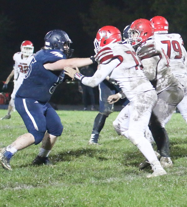 Senior Cory Geist pushes upfield on this pass rush and maintains his pass lane on Friday, October 12, against Wamego.