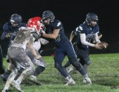 Senior offensive lineman Cauy Rokey seals off his defender on this running play as junior quarterback Gabe Garber prepares to hand off on Friday, October 12.