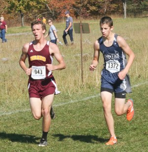 Sophomore Darrin Funk works to pass this Girard runner during the 3A State Meet on Saturday, October 27, at Rim Rock.