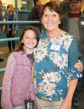 Sabetha Middle School student Claudia Grimm smiles with her grandmother Cindy Frey during the sixth grade Grandparents Day on Tuesday, September 25. Eighty-six grandparents attended with the sixth grade students.