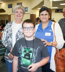 Matthew Herbster waits in the lunch line with his grandmothers Mary Herbster and Lisa Larson during the sixth grade Grandparents Day on Tuesday, September 25.
