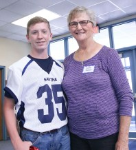 Sabetha Middle School student Jonathan Renyer smiles with his grandmother Cleta Renyer during the eighth grade Grandparents Day on Thursday, September 27. Seventy-two grandparents attended with the eighth grade students.