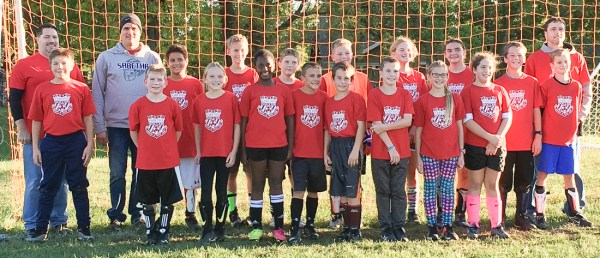 Members of the fifth- and sixth-grade red soccer team are FRONT ROW (L-R) Derek Wahwasuck, Will Voos, Jyllian Stapleton, Krista Edelman, Cole Menold, Philip Anson, Joshua Enneking, Naomi Pearson and Ava Payne; BACK ROW (L-R) Coach Josh Payne, Coach Roger Edelman, Jukobe Jones, Isaac Hartter, Landon Meyer, Roman Scoby, Reve' Nonnast, Morgan Toedman, Marcus Anson, Ryder Smith and Coach Shannon Stapleton. The team placed first in the tournament.