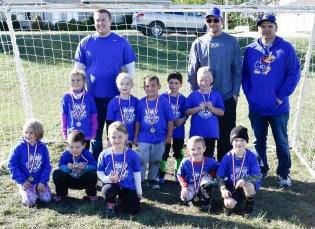 Members of the blue kindergarten soccer team are FRONT ROW (L-R) MacKinley Votruba, Logan McNerney, Kaedyn Meyer, Daxtyn Wasinger and Huck Lowdermilk; SECOND ROW (L-R) Autumn Lang, Lily Hann, Owen Rebant, Grayson Hall and Hadden Strahm; BACK ROW (L-R) Coaches Jacob Strahm, Brad Rebant and Logan Hall. The team went 3-1 during the season and took first in the tournament.
