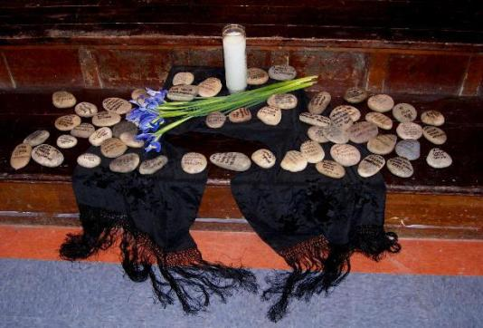 Altar with names of missing women read aloud by audience members...