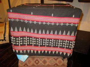 A Katu Sinh - originally beaded with ivory but now with plastic beads woven into the fabric.