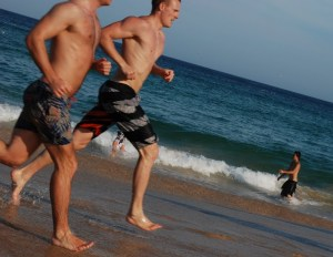people running on the beach