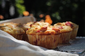 Strawberry rhubarb muffins cooling outside