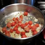 Add tomatoes to add acidity to the scallop recipe
