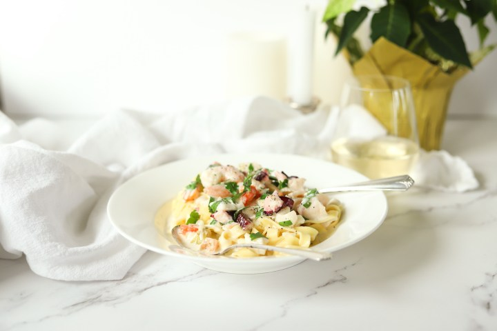 Seafood linguine alfredo with real cream, parmesan and pepper is an easy recipe