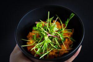 Vegetarian Pea Microgreen Salad On Carrot Risotto