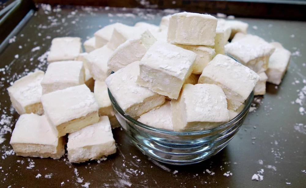 Paleo Marsmallows White and Cubed in a Bowl on a Cookie Sheet