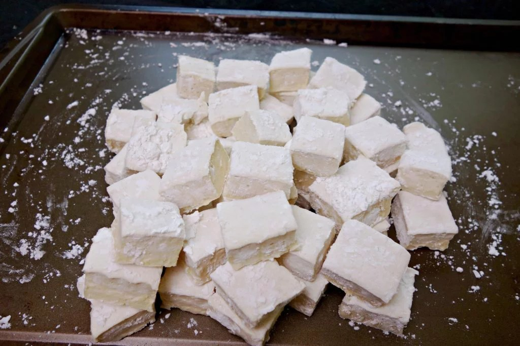 Paleo marshmallows arranged in a pile on a baking sheet