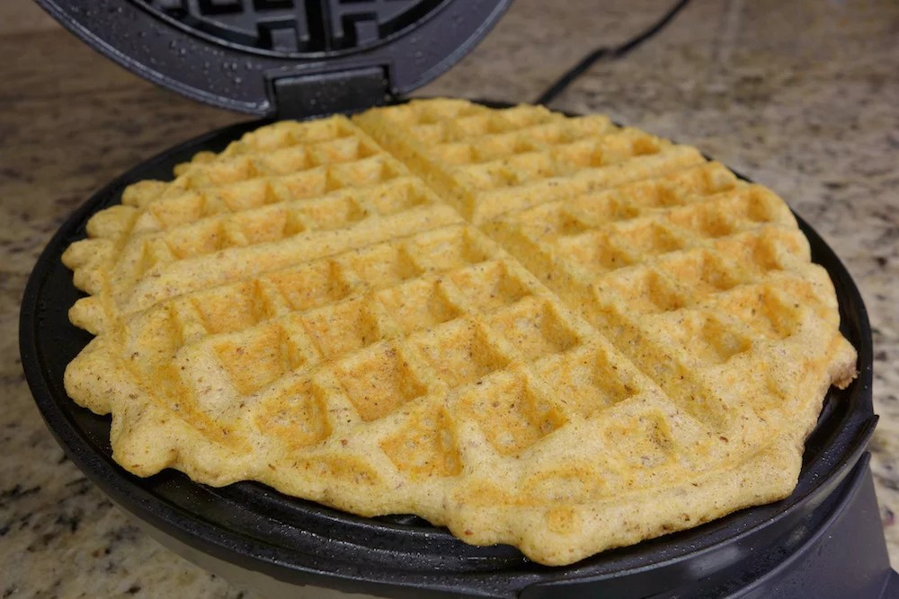 side view of homemade Paleo pumpkin waffles after being cooked on a waffle maker
