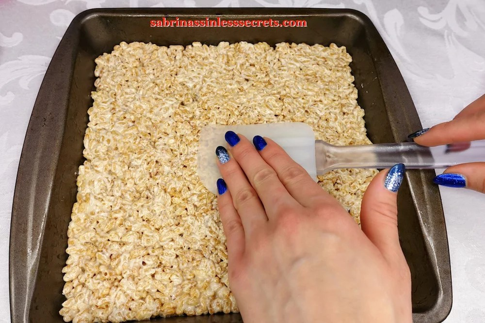 Warm Healthy Brown Rice Crispy Treats (or Bites) ingredients being pressed into a 9x9-inch pan