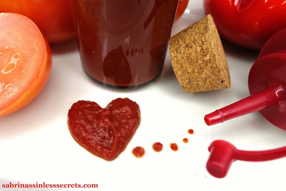 A heart shaped out of homemade Quick & Easy Paleo Ketchup on a white plate