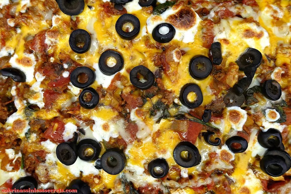 An overhead view of a homemade Gluten-Free Healthy Mexican Casserole straight out of the oven, the cheese slightly browned