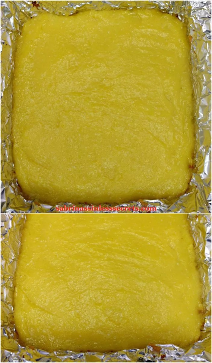 """The baked lemon layer of Paleo Lemon Bars with a Shortbread Crust spread over the crust in a 8""""x8"""" aluminum foil baking dish"""
