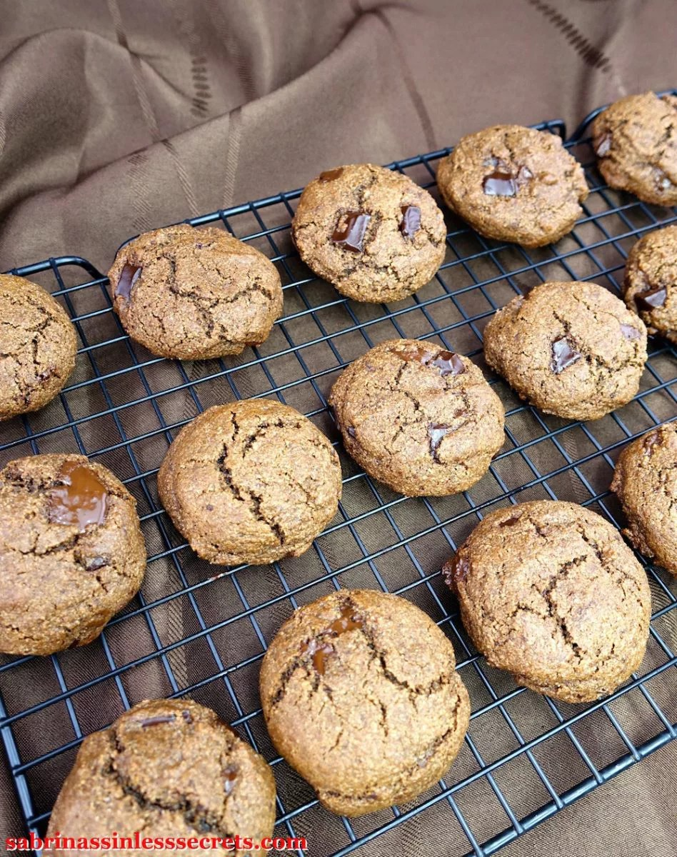 Double Dark Chocolate Chunk Paleo Brownie Cookies fresh out of the oven on a cooling rack