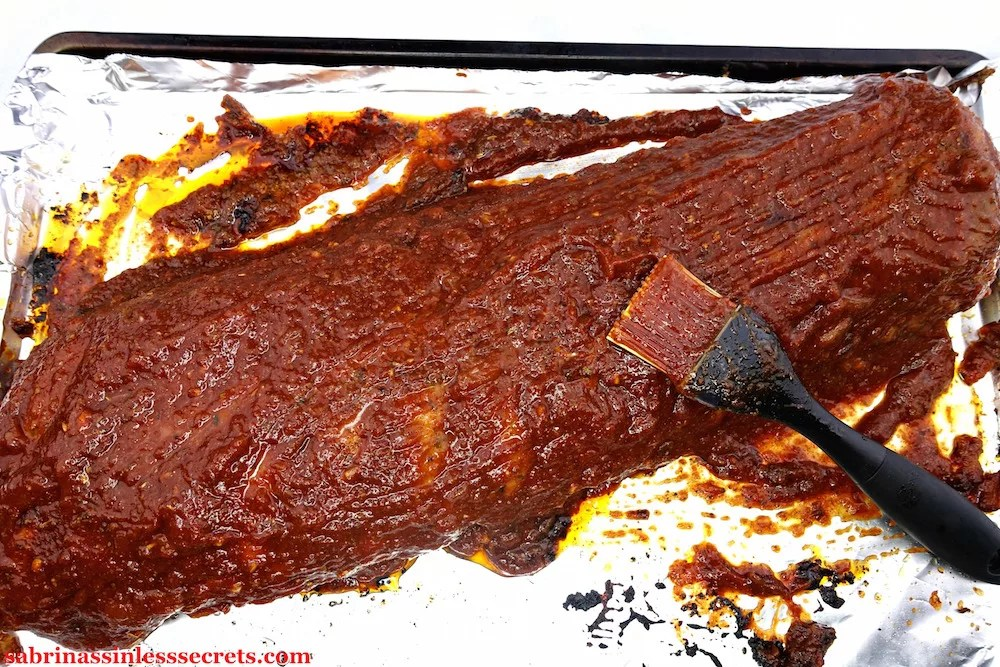 These Oven-Baked Fall Off the Bone BBQ Paleo Ribs are so tender, juicy, and full of BBQ flavor! They're sure to satisfy your rib cravings this summer, or anytime of the year! You don't have to worry about owning a barbecue grill or crock-pot—you can make these delicious, fall off the bone ribs right in your oven! They're gluten-free, refined sugar-free, dairy-free, and clean-eating!
