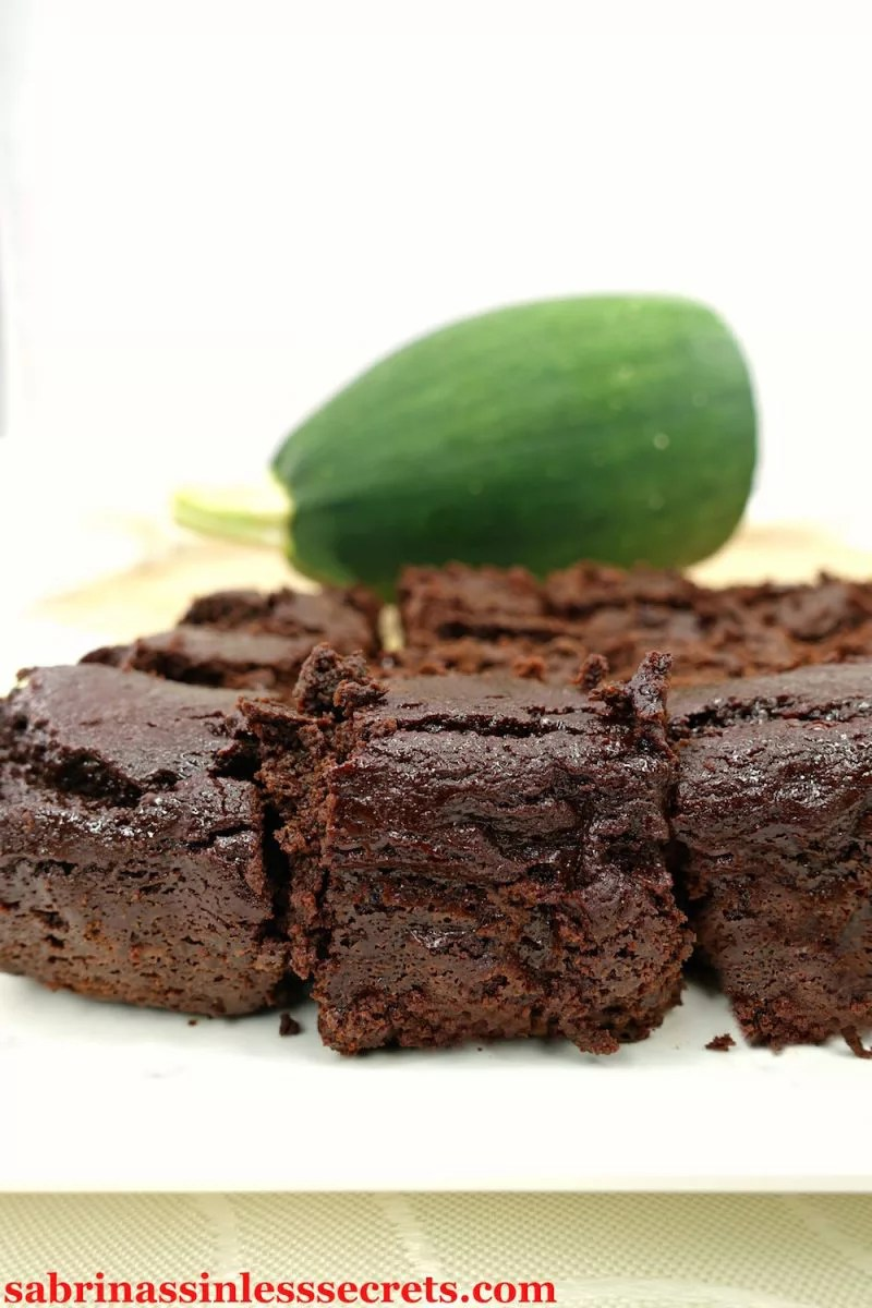 These Paleo Zucchini Blender Brownies are thick, chocolatey, sweet, fudgy, moist, and airy all at the same time. You won't be able to taste or see the zucchini in these brownies at all—making them the perfect sinless snack or dessert for your kids … and ANYONE else. These clean-eating brownies are gluten-free, dairy-free, refined sugar-free, grain-free, oil-free, and have a vegan option!