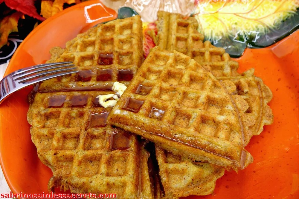 Paleo Pumpkin Waffles plated and covered with syrup