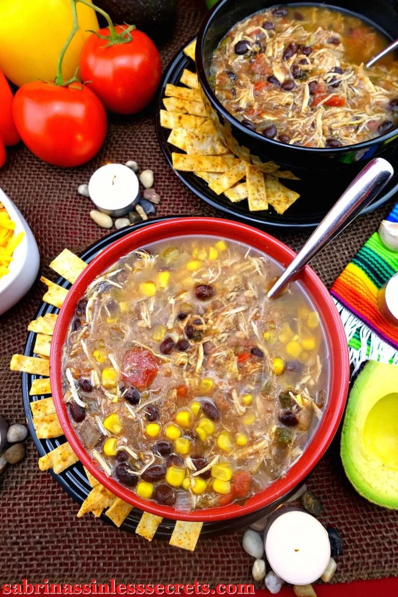 This Gluten-Free Slow-Cooker Tortilla Chicken Soup is the perfect sinless comfort food! The warm, mildly spicy Mexican flavors pair wonderfully with fall. One of the best things about this soup is that the slow-cooker will do all the hard work for you—so, add all the fresh vegetables, chicken breasts, herbs and spices in your all-mighty crockpot and let your house fume with Mexican goodness!