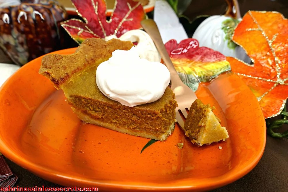 Closeup of paleo pumpkin pie, fork, and whipped cream