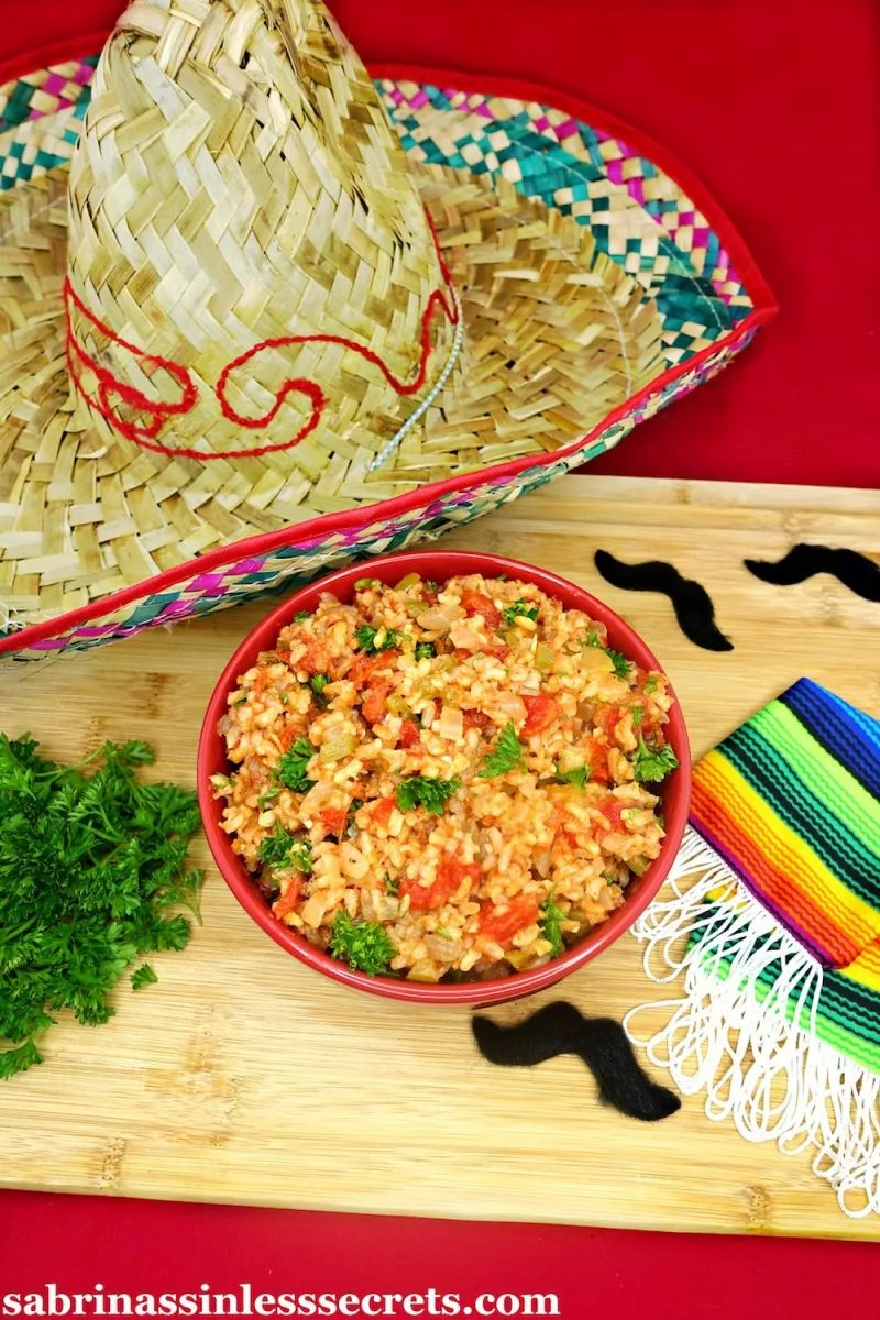 Throw out the packaged Mexican rice that's filled with preservatives! You can now have a delicious, homemade Skinny and Simple Mexican Rice made with natural ingredients! It's quick and easy to prepare and makes the perfect side dish to Mexican night. With just the right amount of spiciness and ample Mexican flavors, this gluten-free, vegan, guilt-free, and clean-eating rice will be your new go-to!