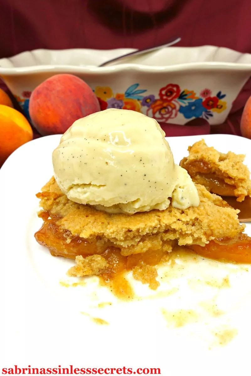 Fresh peaches, tossed with cinnamon and nutmeg, get overlaid with a fluffy and crisp gluten-free topping—offering you a warm dessert that'll blow your mind! The combination of this comforting dessert with some cold vanilla bean ice cream really makes a perfect treat! This Paleo and Vegan Peach Cobbler is Paleo, gluten-free, grain-free, vegan, dairy-free, refined sugar-free, clean-eating, and addictively delicious!