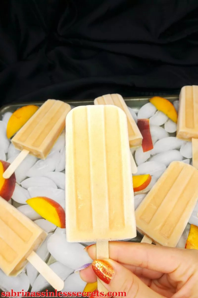 The sweet flavors of chilly peach on a hot summer day is sure to mend the heat pain away! These Paleo and Vegan Peach Cream Popsicles are such a refreshing and satisfying treat! You won't feel like you're eating gluten-free, grain-free, refined sugar-free, vegan, dairy-free, egg-free, or clean-eating, and you certainly won't miss the store-bought, sugar-filled popsicles!