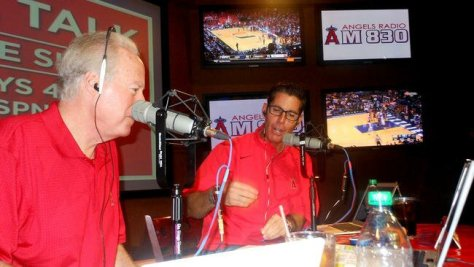 Broadcasters Terry Smith, left, and Victor Rojas talk to fans during a call-in show on 830 AM. (Facebook)