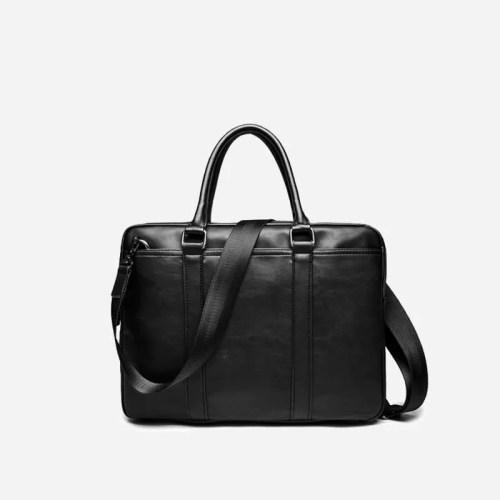 Sac à bandoulière et sac à main en cuir noir pour homme avec plusieurs poches zippées et poches intérieures. Vormbag Famous