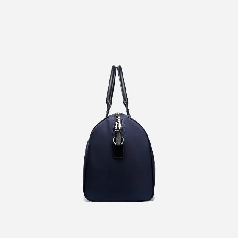 Sac à bandoulière et sacoche bleu pour homme avec plusieurs poches zippées et poches intérieures. Bopaibag Classic. Coté.