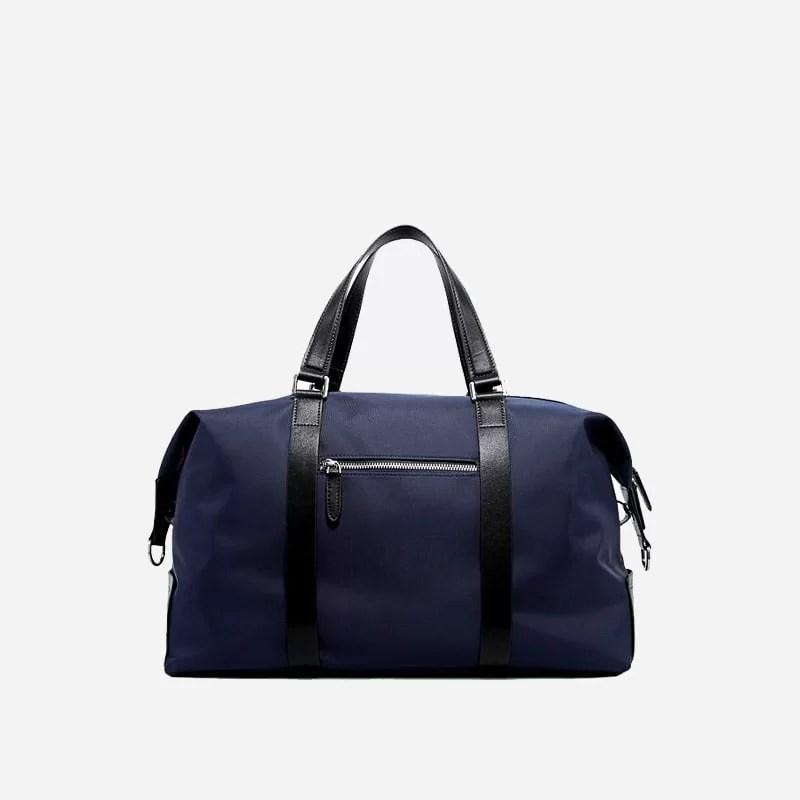 Sac à bandoulière et sacoche bleu pour homme avec plusieurs poches zippées et poches intérieures. Bopaibag Design. Verso.