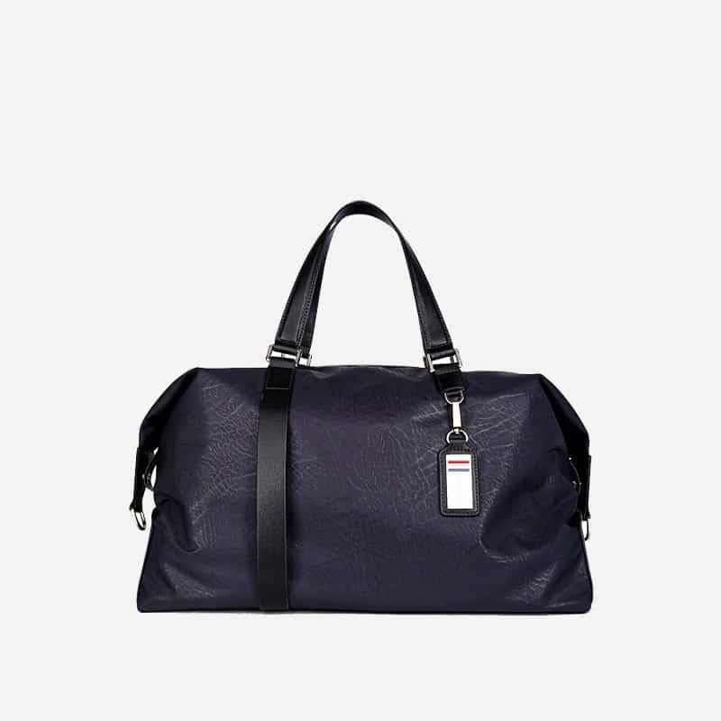 Sac à bandoulière et sacoche bleu nuit pour homme avec plusieurs poches zippées et poches intérieures. Bopaibag Design.