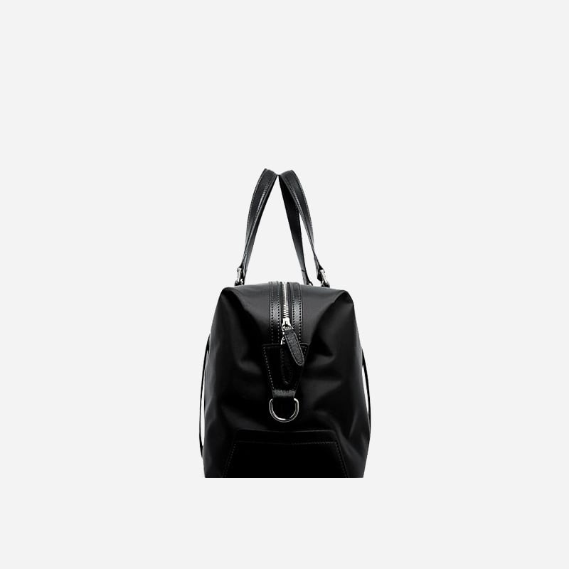 Sac à bandoulière et sacoche noir pour homme avec plusieurs poches zippées et poches intérieures. Bopaibag Design. Coté.