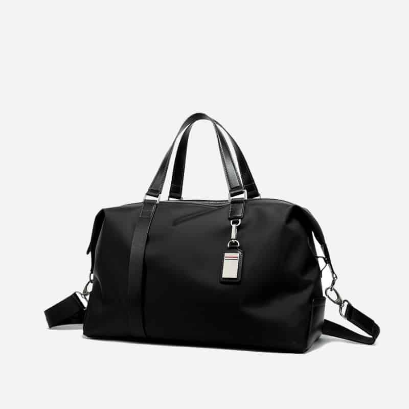 Sac à bandoulière et sacoche noir pour homme avec plusieurs poches zippées et poches intérieures. Bopaibag Design. Zoom.