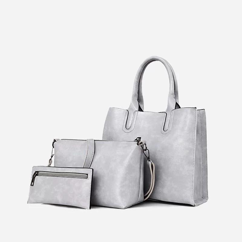Set de sacs pour femme en cuir gris. Sac à main., sac bandoulière et pochette.